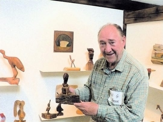 Bill Graham and some of his wood carvings.  In recent