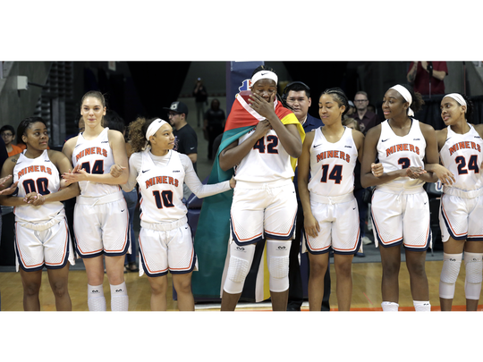 UTEP senior Tamara Seda gets emotional as she takes the floor with her team for the final time at the Don Haskins Center.