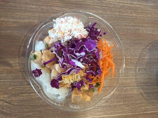 A small poke bowl of rice, spicy tuna, scallops, crab