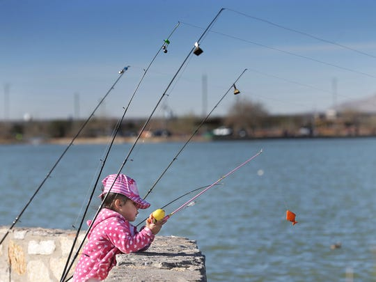 Azalea Melendez, 2, learns to fish in March during the Kid Fish Rally at Ascarate Lake. The event, which is hosted by the Ascarate Fishing Club, teaches children to fish and gives them an opportunity to participate in outdoor activities. About 500 kids turned out for the event.