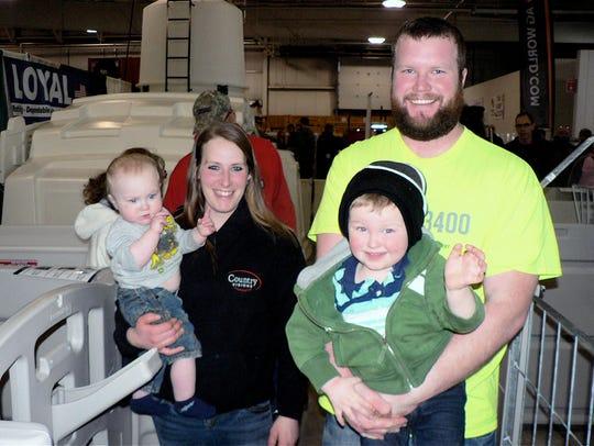 Vanna (holding 1-year-old Everett ) and Mark Leichtfuss