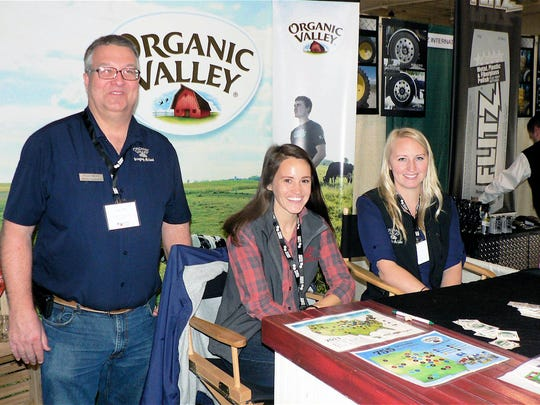 Glenn Hoff, Carley Bosshard (middle) and Melissa Weyland, of Organic Valley Co-op, answered questions but were not signing up new milk patrons.