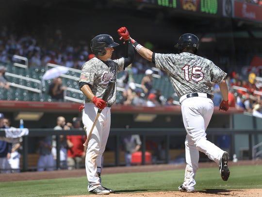 El Paso's Brett Nicholas celebrates his home run against