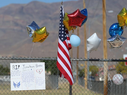 A memorial was erected where Parkland Middle School sixth-grader Jonathan Benko jumped the fence and was killed by a passing vehicle Friday. Benko left a national anti-gun walkout with other students.