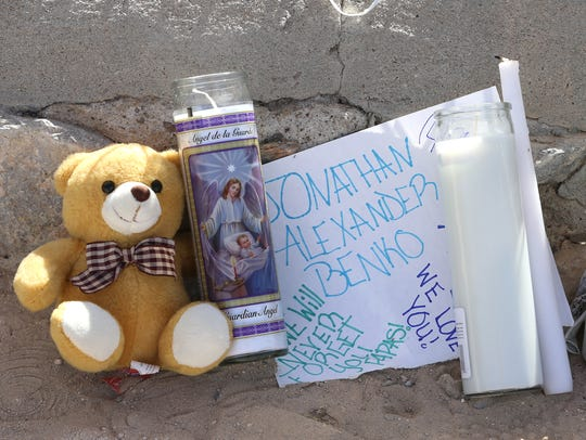 Several candles, notes and stuffed animals were left