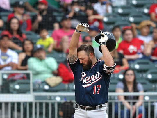 Former Chihuahua Cody Decker wipes away the sweat during