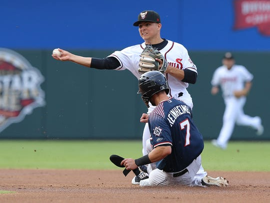 El Paso's Luis Urias turns a double play as Reno's