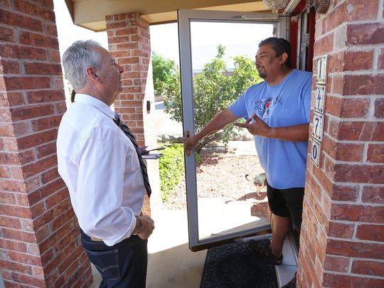 Ricardo Samaniego, candidate for county judge, talks with Ray Resendez while block walking May 5 in East El Paso.