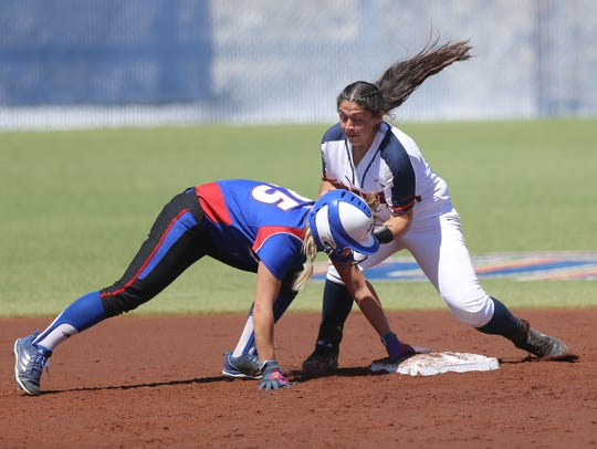 UTEP's Ariana Valles tries to tag Louisiana Tech's