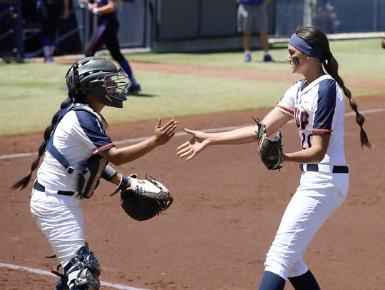 UTEP pitcher Kira McKechnie gets some love from catcher