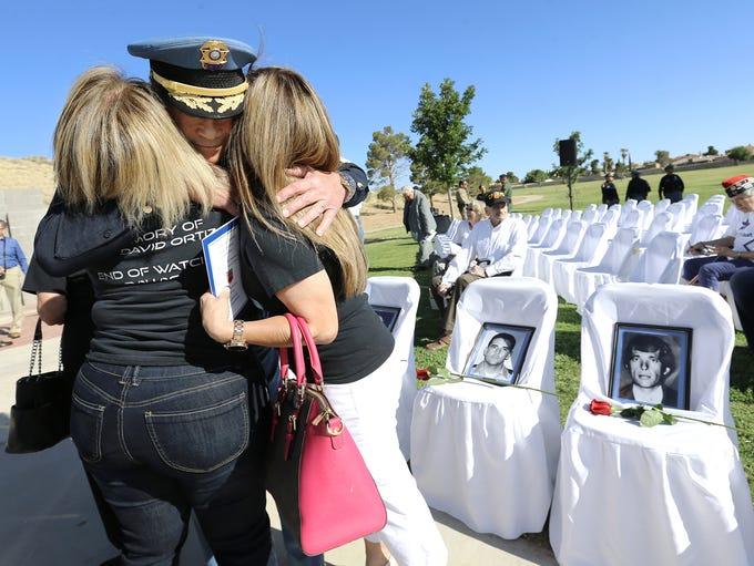 El Paso Police Chief Greg Allen hugs Rebecca Andrade