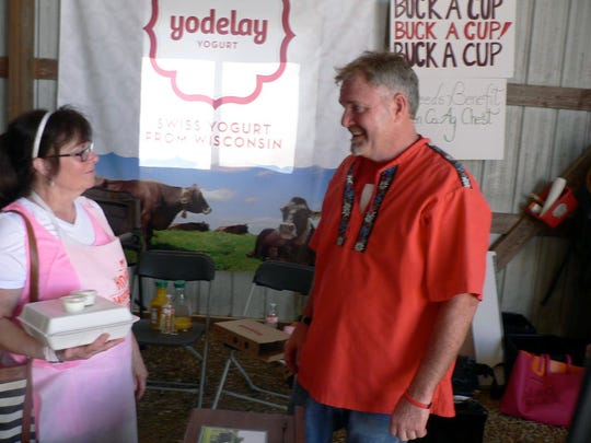 Bryan Voegli who milks 220 cows, recently began marketing Yodolay yogurt made from his farm milk, talked yogurt with a display at the breakfast.  He also provided a sample with each meal.
