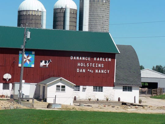 The dairy barn still carries the words from before the Holstein herd was sold after Dan Karlen died.