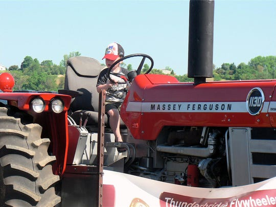 Youngsters love the display of old tractors imagining