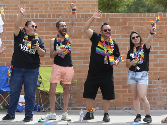 Spectators cheer as floats pass by at the Sun City Pride Parade in downtown El Paso Saturday.