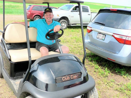 Leo Acker was one of the many drivers of golf carts