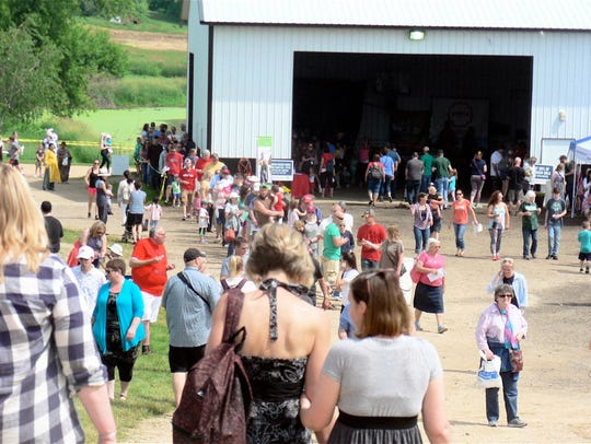 The food line and people walking to the exhibitor displays