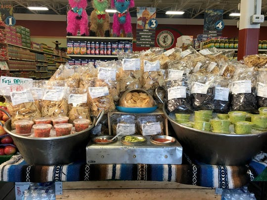 Fresh salsa and guacamole in the produce section at