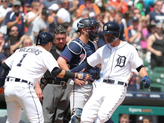 JaCoby Jones is met by shortstop Jose Iglesias, after hitting a two-run homer against the Twins during the seventh inning Thursday at Comerica Park.