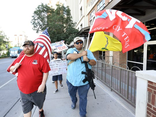 Protesters march in front of the El Paso Community