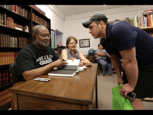"""Carlos Loweree III has his copy of """"Black Klansman"""""""