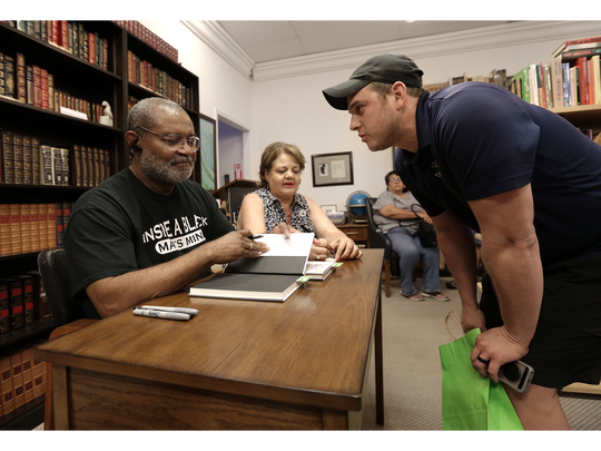 "Carlos Loweree III has his copy of ""Black Klansman"" signed by author Ron Stallworth on July 14 at Literarity Book Shop in West El Paso."