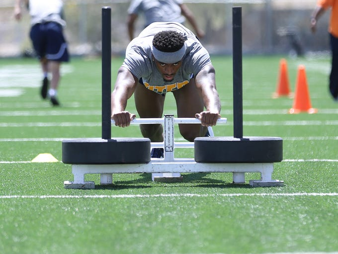 UTEP football players work on conditioning on July