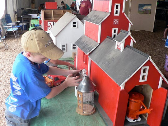 The model farmstead was a favorite of  youngsters.