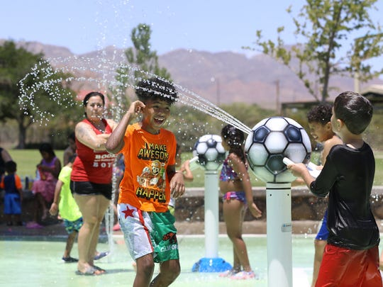 The temperatures are expected to remain in triple digits through Tuesday with an expected high of 107 on Monday. Above, kids cool off at the splash pad at Sue Young Park in northeast El Paso.