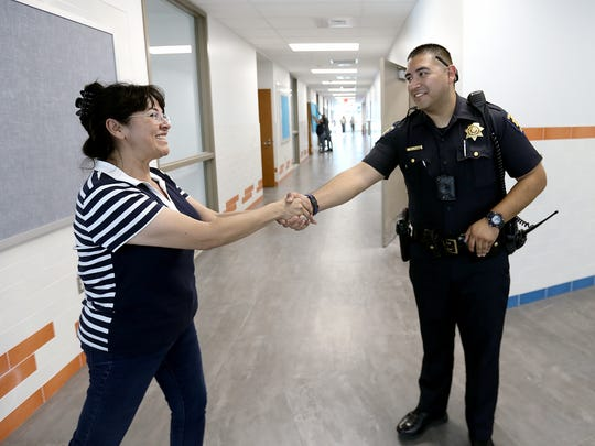 Constable Steven Carrasco meets teachers at Sgt. Jose F. Carrasco Elementary which is named for his father who was a long-time officer with the Socorro Independent School District. The new school is ready to accept students on Monday.
