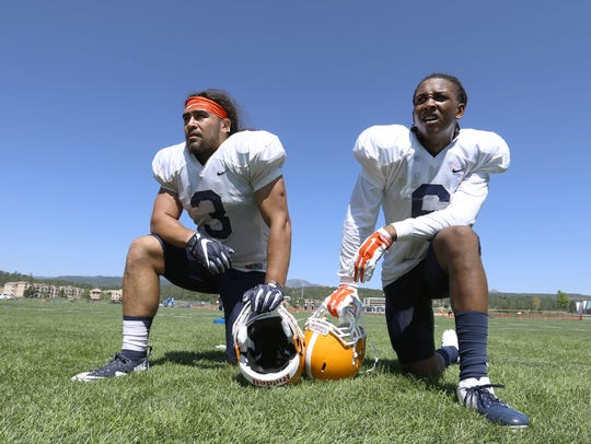 UTEP linebackers Sione Tupou, left, and Dylan Parsee