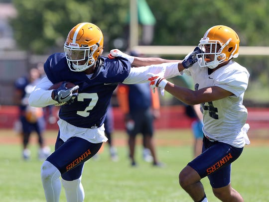 UTEP wide receiver Kavika Johnson stiff arms defensive