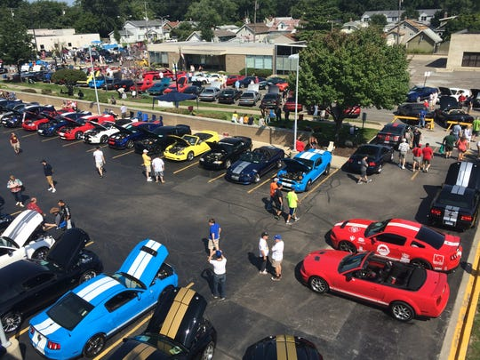 """The """"snake pit"""" full of Ford Mustang Cobras is seen on East Nine Mile on Aug. 16, 2014 along Mustang Alley in Ferndale during the Woodward Dream Cruise."""