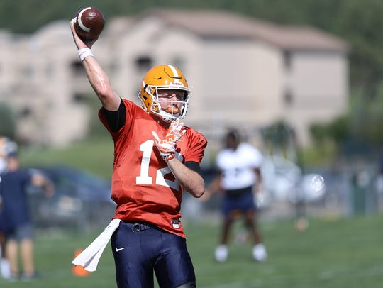 UTEP quarterback Ryan Metz throws during a drill Tuesday