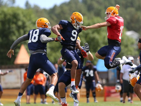 UTEP freshman quarterback Calvin Brownholtz, right, and tight end David Lucero converge on senior wide receiver Alan Busey after an improbable reception from senior quarterback Ryan Metz on Aug. 8 at Camp Ruidoso.