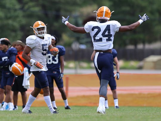 UTEP defensive back Kahani Smith celebrates Nik Needham's interception Wednesday at Camp Ruidoso.