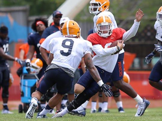 UTEP sophomore quarterback Mark Torrez takes off on