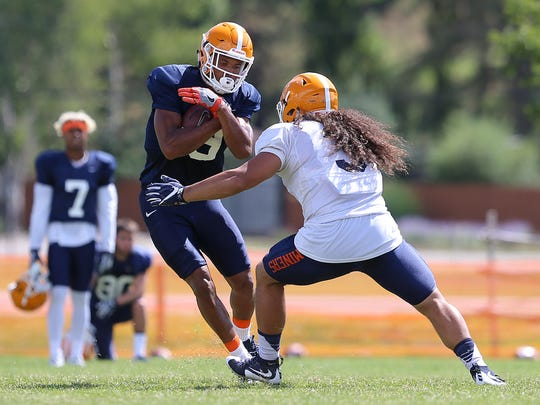 UTEP senior wide receiver Alan Busey tries to avoid freshman linebacker Sione Tupou on a play Wednesday at Camp Ruidoso.