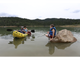 Lucas Bohannan, 8, welcomes Dale and Cheryl Watkins back from their kayak trip at Grindstone Lake in Ruidoso Thursday.