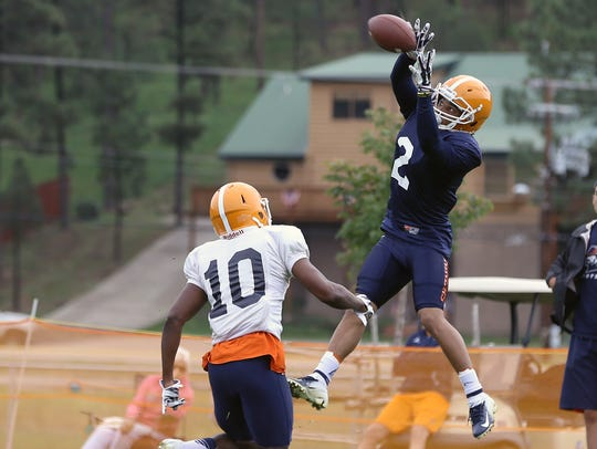 UTEP's Terry Juniel catches a pass over defensive back