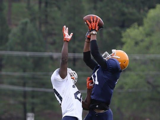 UTEP wide receiver Erik Brown catches a touchdown pass over safety Jake Sammut Friday.