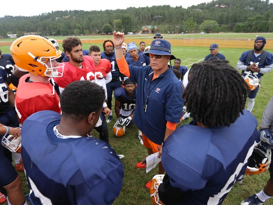 UTEP offensive Coordinator and Quarterbacks Coach Mike Canales huddles with his offense at Camp Ruidoso.