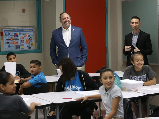 EPISD Superintendent Juan Cabrera peeks in on a New Tech classroom at Brown Middle School Monday. EPISD schools returned to classes Monday.