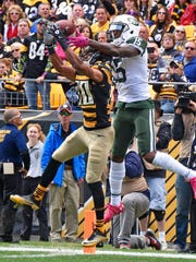 Brandon Marshall hasn't caught a touchdown since this Week 5 grab in Pittsburgh. He has only two touchdowns on the season. (AP Photo/Don Wright)
