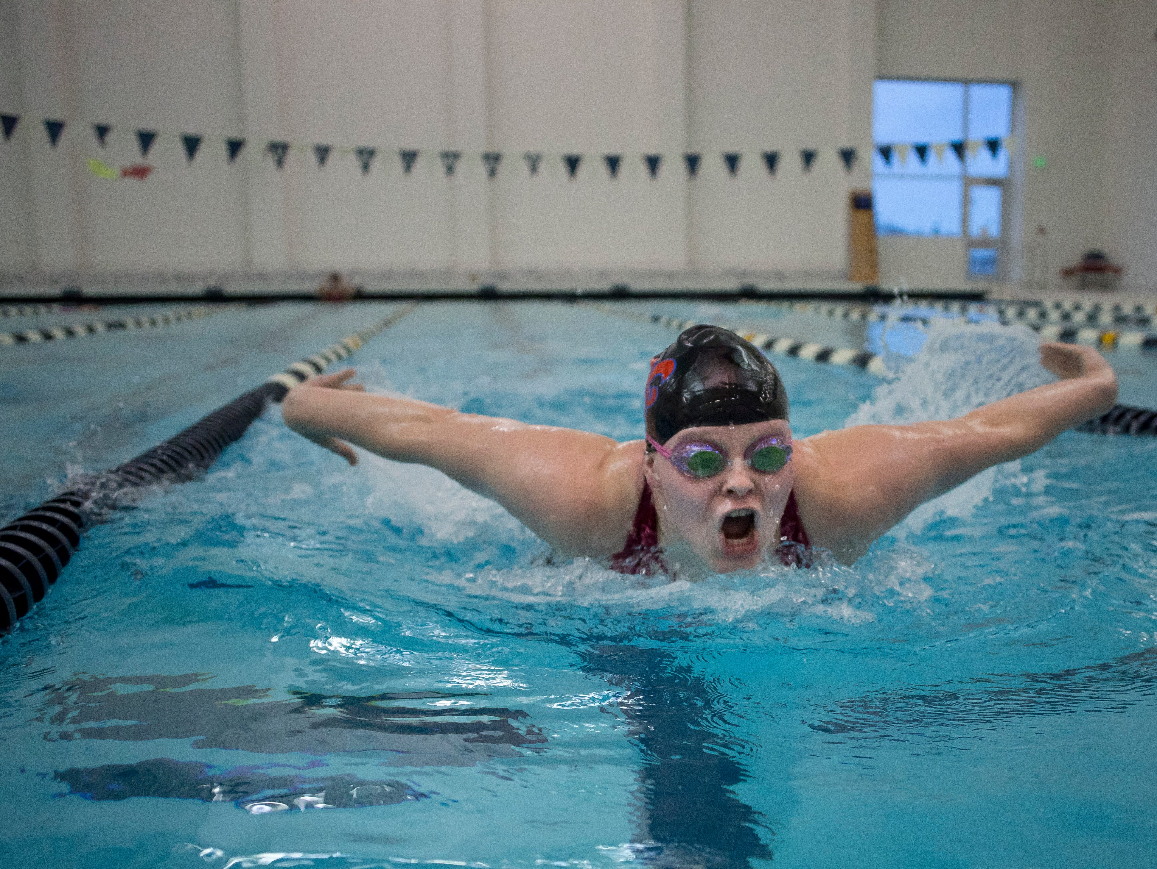 St. Clair senior Alexis Smith does the butterfly stroke during practice Wednesday, November 18, 2015 in Marysville.