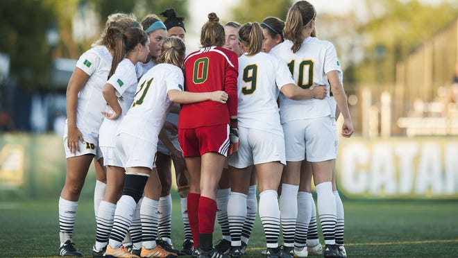 Vermont huddles together during the women's soccer game between the Central Connecticut State Blue Devils and the Vermont Catamounts at Virtue Field on Friday night August 26, 2016 in Burlington.