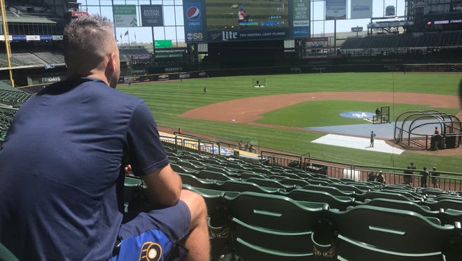 """Brewers reliever Dan Jennings plays """"Fortnite"""" on Miller Park's center field scoreboard, as portrayed on the Brewers' Twitter account."""