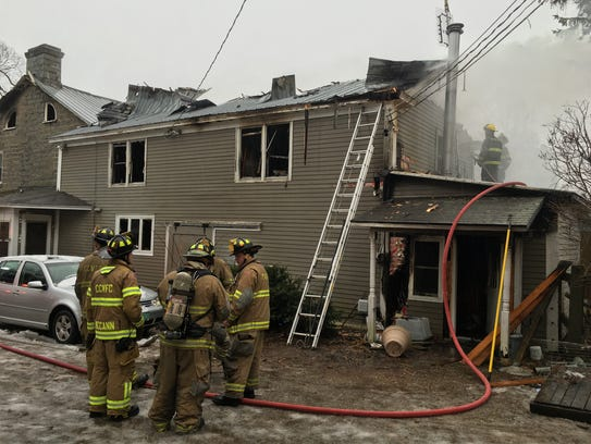 Firefighters regroup after fighting a blaze Wednesday