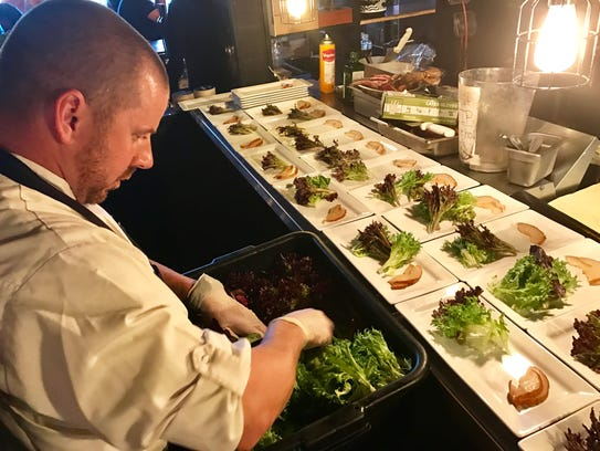 Chef Reuben Sliva plates the salad course for his farewell