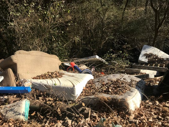A garbage dump along Twin Creek Road in South Knoxville